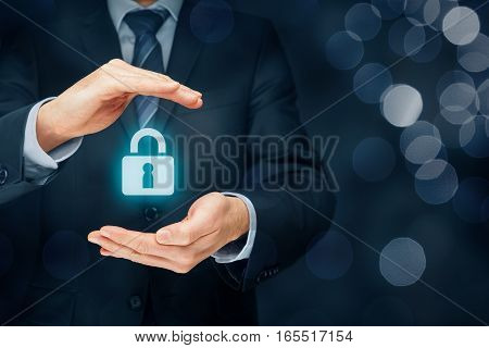 Security services and protection concept. Login, sign in concepts. Businessman offer padlock, symbol of security. Left composition with bokeh in background.