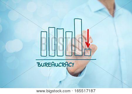 Bureaucracy reduction concept. Businessman draw graph with bureaucracy reduction, bokeh in background.