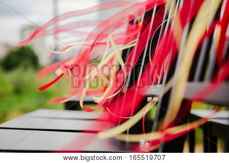Red satin ribbon. Wedding decor red nature