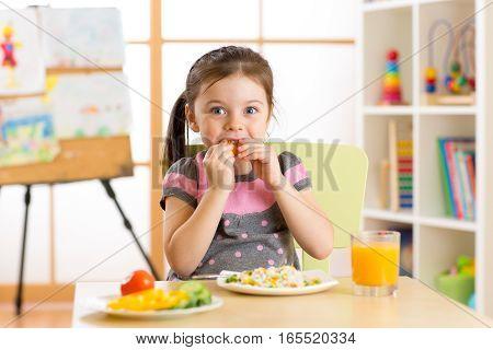 Beautiful child kid girl drinking healthy food