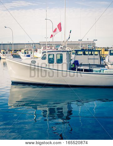 Reflection of a lobster fishing boat at a harbour