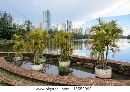 Londrina PR Brazil - December 24 2016: Lake Igapo in Londrina. Structure made of decorative stones with some palm trees.