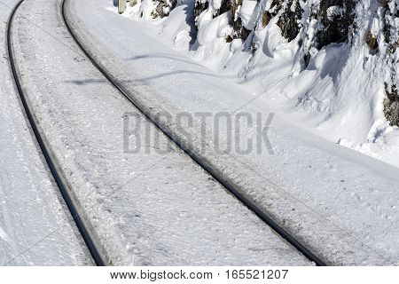 Railway Line in Heavy Snow. Railroad Through the Winter Nature. Train Tracks in Cold Sunny Day.