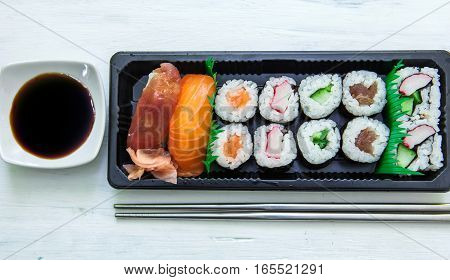 sushi box with soya sauce and chopstick