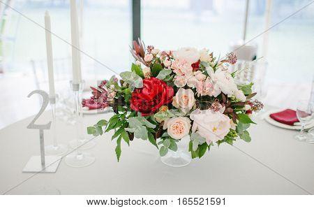 Flower arrangement wedding table. Wedding decor nature