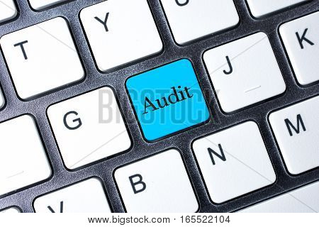 Audit button word on white computer keyboard