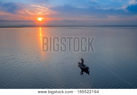 Fisherman of Bangpra Lake in action when fishing Thailand