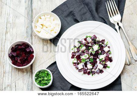 Roasted beet feta parsley salad on wood background