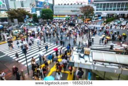 Blurred Crowd of People On Street at ShibuyaTokyoJapanVintage Toned Image. Blur image background concept.