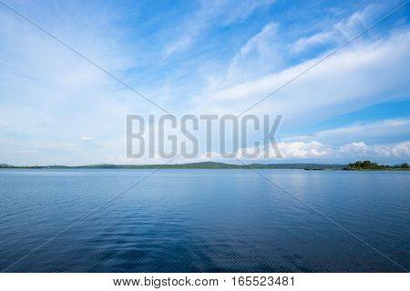 Blue Lake With Clear Sky And Green Mountain