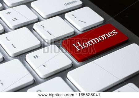 Hormones on Red Enter Button on white keyboard