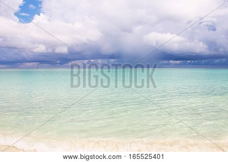 Seascape - bright azure Caribbean Sea and cumulus clouds. Picture taken in Cuba.