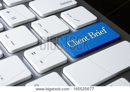 Client Brief word on blue enter computer keyboard