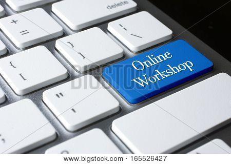 Online Workshop word on blue enter keyboard