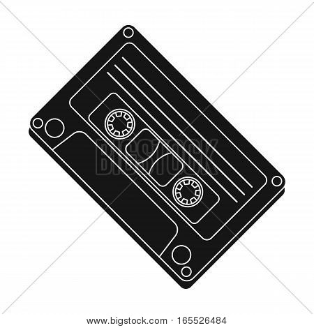 Audio cassette icon in black design isolated on white background. Hipster style symbol stock vector illustration.