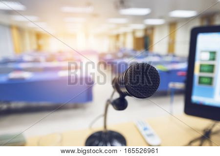 Microphone on the table with computer in seminar room with vintage tone