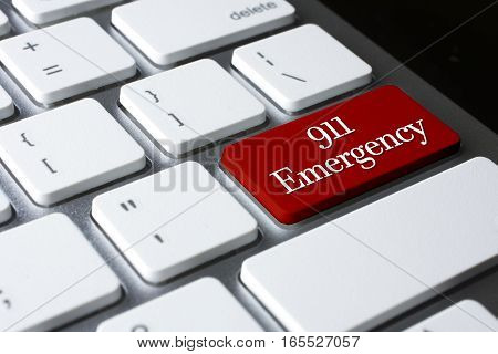 911 Emergency at enter key on white keyboard