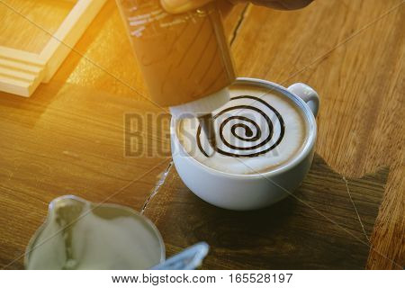 Making mocha art with chocolate in vintage tone