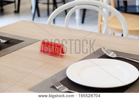 Red reserve sign on the table in restaurant