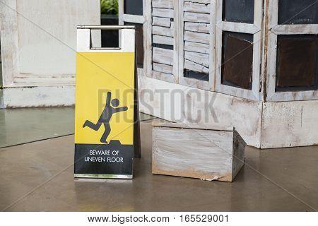 Beware uneven floor sign at department store