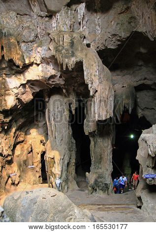Khao luang cave, Thailand - March 25, 2015: people are leaving Khao luang cave after exploration Thailand
