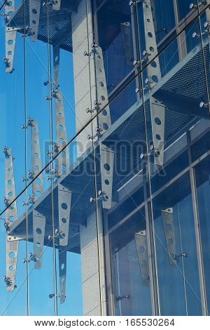 Glass curtain walls. Spider facade fixing system. Elements of fastening of the facade