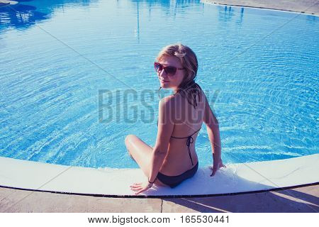 Sporty Blond Girl At The Swimming Pool