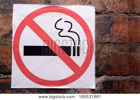Close-up image of informative no smoking sign