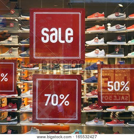 Utrecht, Netherlands, 14 january 2017: sale sign and discount numbers on shop window of shoe store