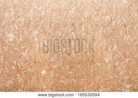 OSB plywood or oriented strand board wood wall background texture