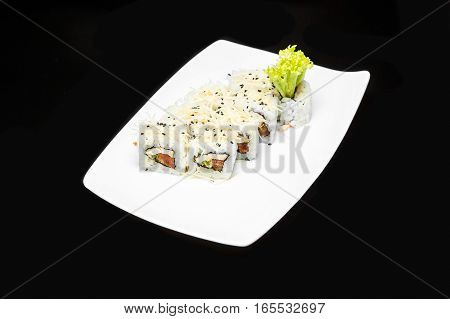 sushi rolls set with chicken fillet Caesar dressing and Parmesan cheese on a black background