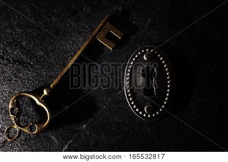 Vintage lock with a gold key on grunge background