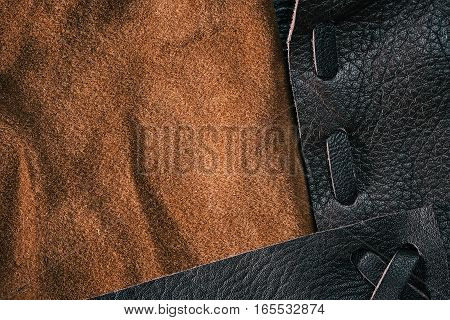 Combined background of brown suede and stitched leather. Macro view