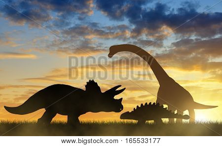 Silhouette of dinosaurs in the sunset sky