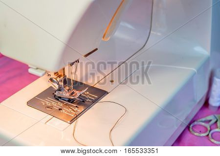 Close-up image of modern sewing machine foot