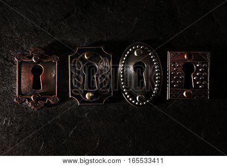 four vintage locks on a dark background