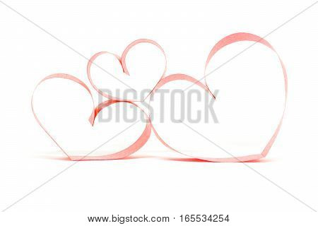 Valentine's day card - hearts made of red ribbon on white background.