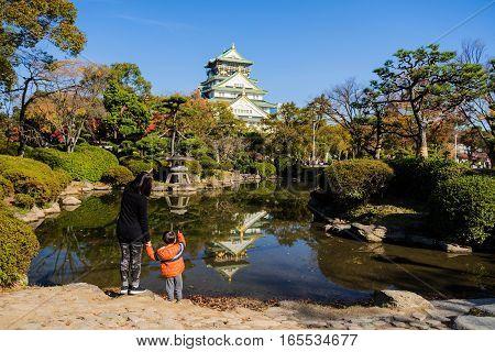 Family At Osaka Castle In Autumn