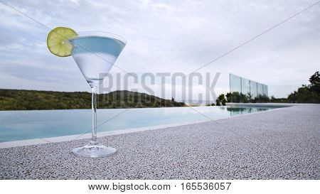 Martini glass poolside infinitely looking out to sea...