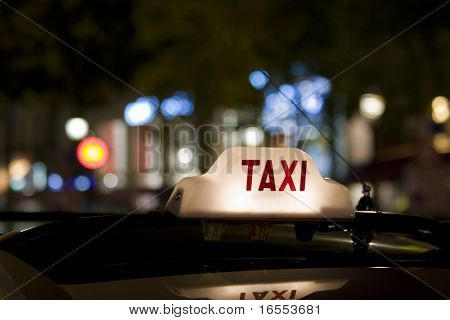 Taxi waiting for a fare in the city with its sign illuminated