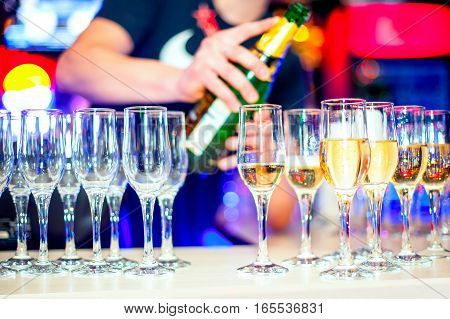 Glasses of champagne in a nightclub at the front of the bar