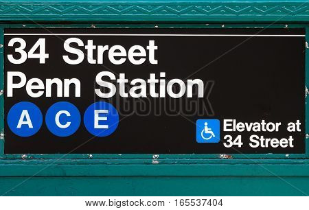 NYC subway sign at Penn Station and 34th Street for the ACE train line in Manhattan New York City