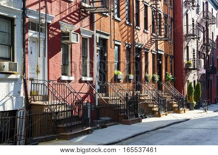Sunlight shines on a block of historic apartment buildings on Gay Street in the Greenwich Village neighborhood of Manhattan New York City