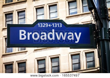 Broadway street sign with building background near 34th Street and Herald Square in Manhattan New York City NYC