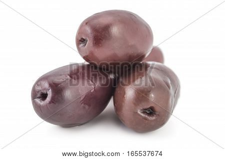 Pile of fresh raw purple black kalamata olives, isolated on white background
