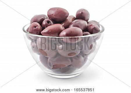 Bunch of fresh raw purple black kalamata olives in the glass bowl, isolated on white background