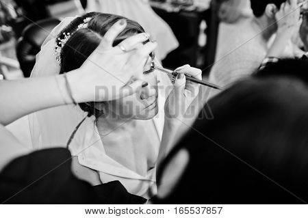 Stylist Makes Make Up Bride On The Wedding Day At Beaty Salon. Black And White Photo