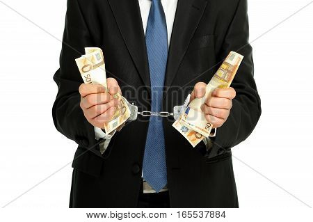 man in suit with handcuffs and holding banknotes