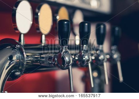 Barkeeper pulling a pint of beer behind the bar