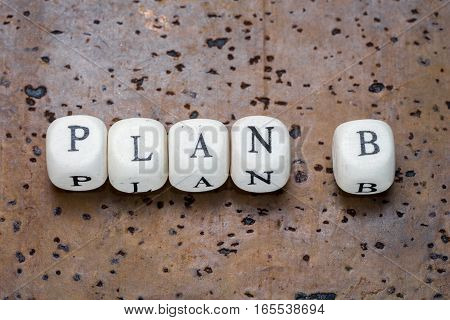 Plan B Text On Wooden Cubes On A Brown Cork Background